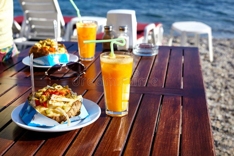 Kumpir and juice in Cafe stock images