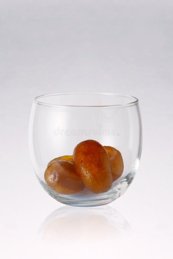 Kumquat cristalizado imagem de stock