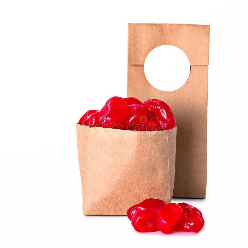 Kumquat vermelho no pacote do ofício fotografia de stock royalty free