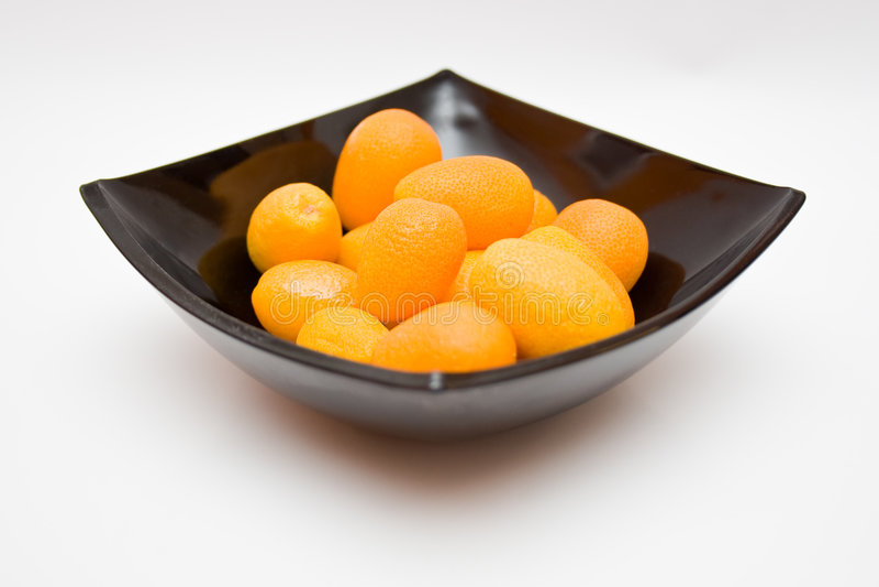 Kumquats in een Kom royalty-vrije stock afbeelding