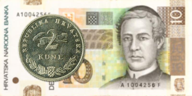 kunamynt för 2 kroat mot kunasedel för 10 kroat royaltyfri fotografi