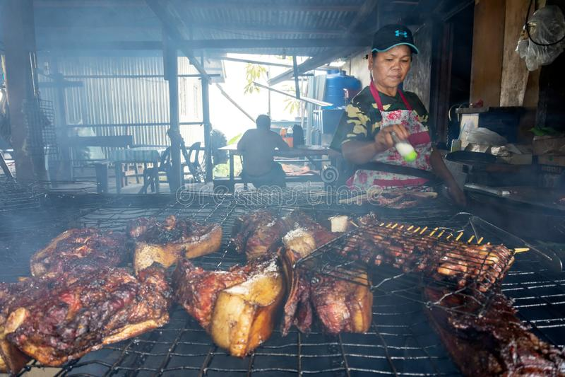 Vendor preparing a barbecue wild boar, stock photography