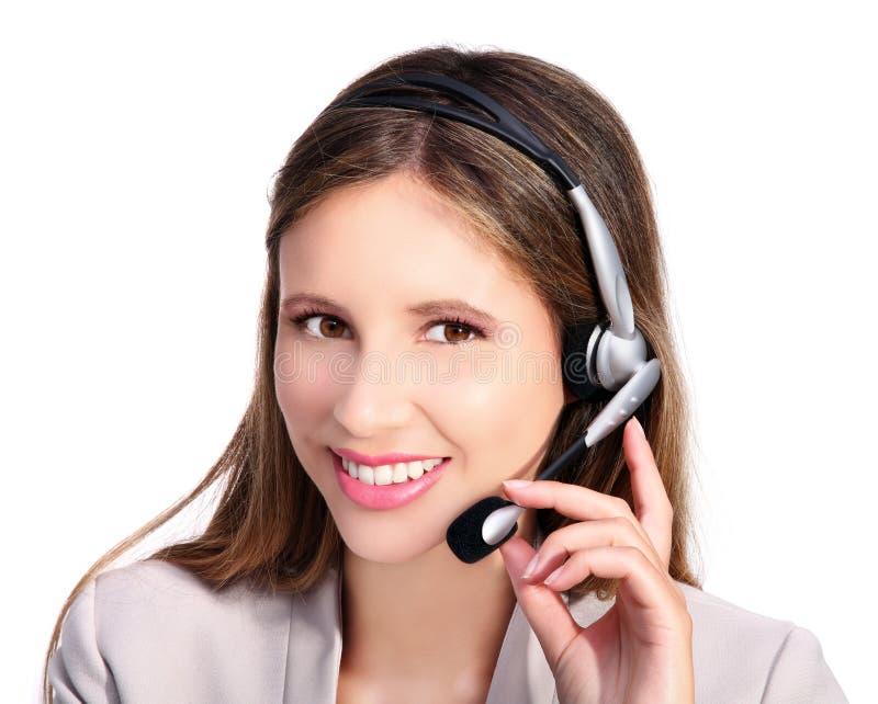Kundtjänst som ler flickan med hörlurar och mikrofonen arkivfoton