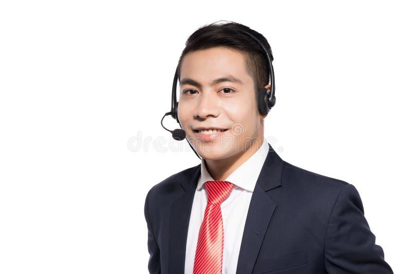 Kundtjänstrepresentant som bär en hörlurar med mikrofon royaltyfria bilder