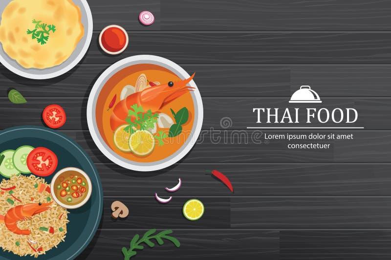 Kung de Tom yum dans la cuvette sur la vue supérieure en bois noire de table La Thaïlande a placé le fond de nourriture illustration libre de droits