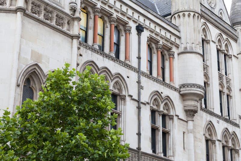Kungliga domstolar, gotisk stilbyggnad, fasad, London, Förenade kungariket royaltyfri bild