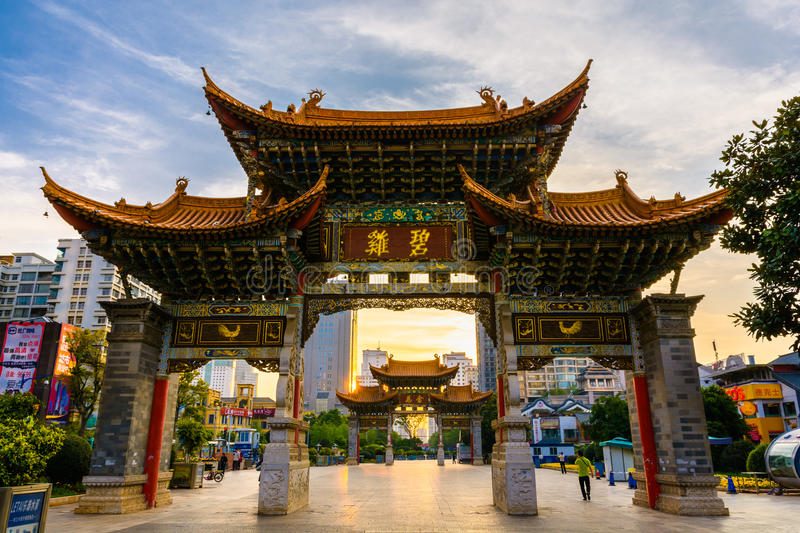Kunming gate. KUNMING-MARCH 15, 2015. Illuminated arches downtown, The golden horse gate in morning light stock photo