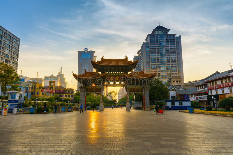 Kunming gate. KUNMING-MARCH 15, 2015. Illuminated arches downtown, The golden horse gate in morning light royalty free stock image