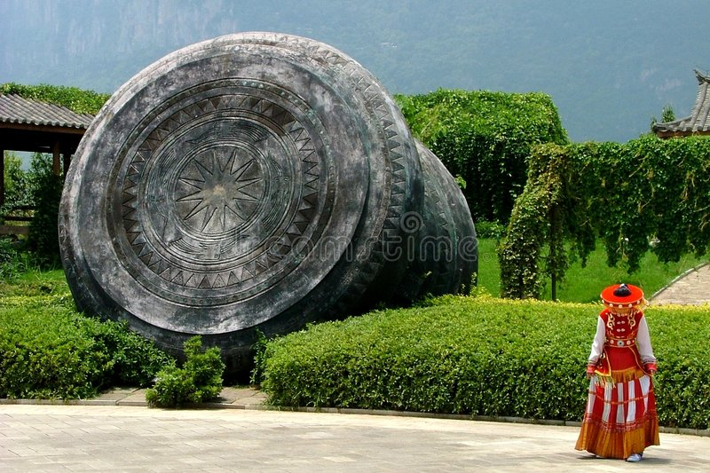 Kunming Girl. Girl in front of a stone sculpture in Kunming, Yunnan province, China royalty free stock photography