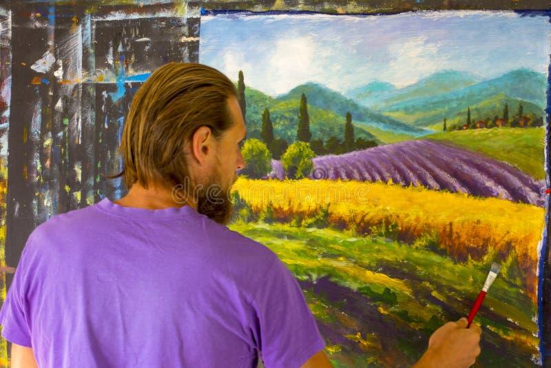 Kunst creatief proces De kunstenaar creeert het schilderen Italiaans de zomerplatteland toscanië Gebied van rode papavers, een ge royalty-vrije stock foto's