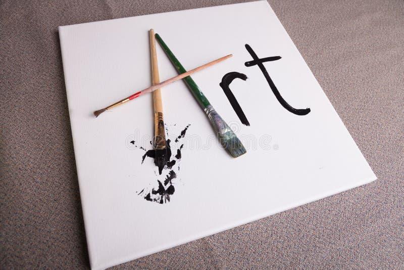 Kunst geschrieben auf Segeltuch in Pinsel und in schwarze Farbe stockfotos