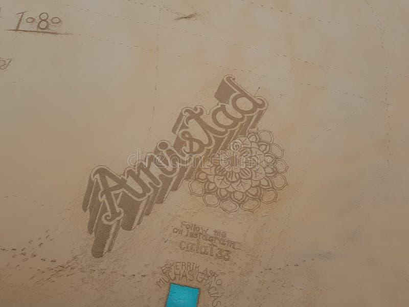 Kunst op het strand van shell stock afbeelding