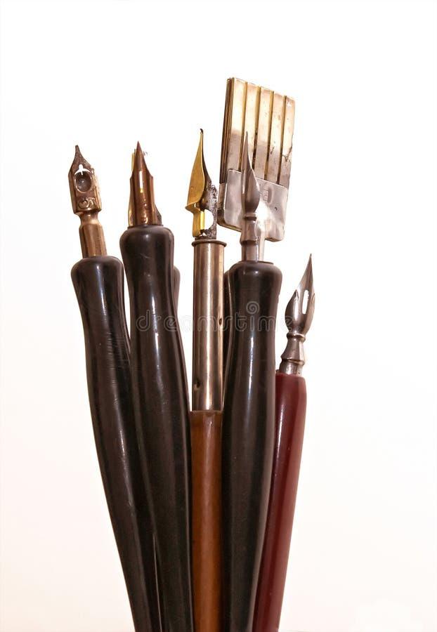 Kunstenaar die en pen schrijft trekt royalty-vrije stock foto