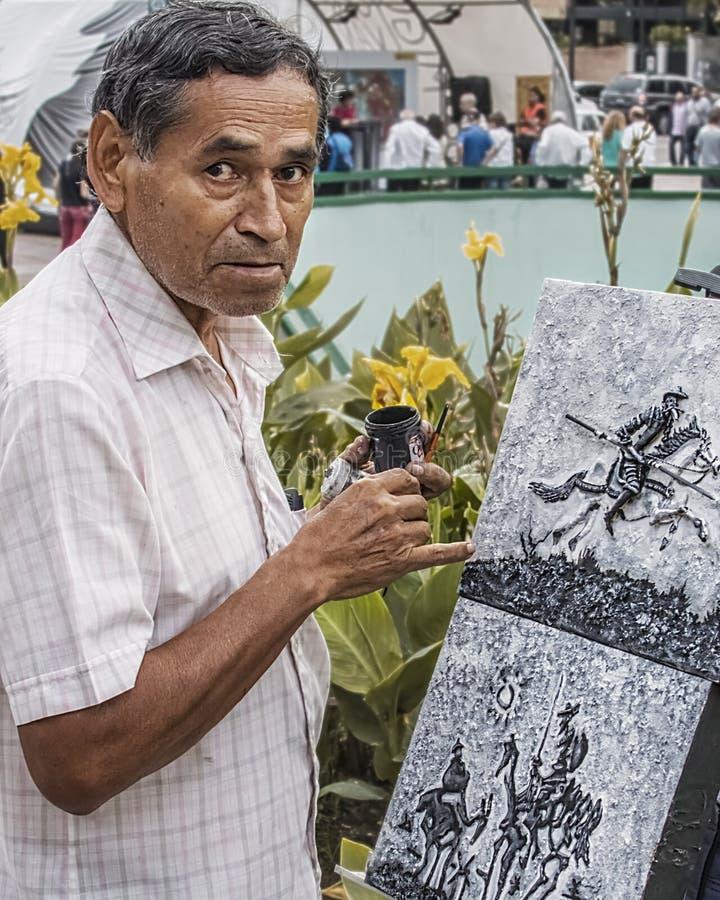 Kunstenaar het schilderen op de straat in Caracas Venezuela, portret royalty-vrije stock fotografie