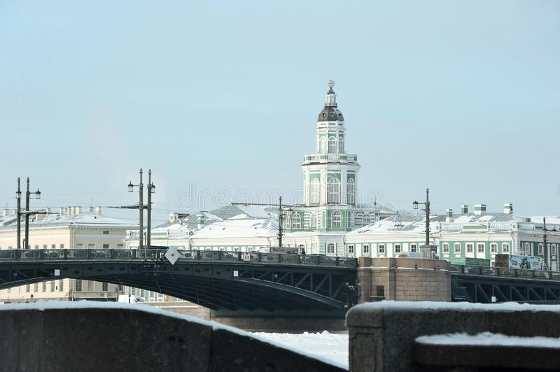 Kunstkamera building and view of Palace bridge in winter stock photos