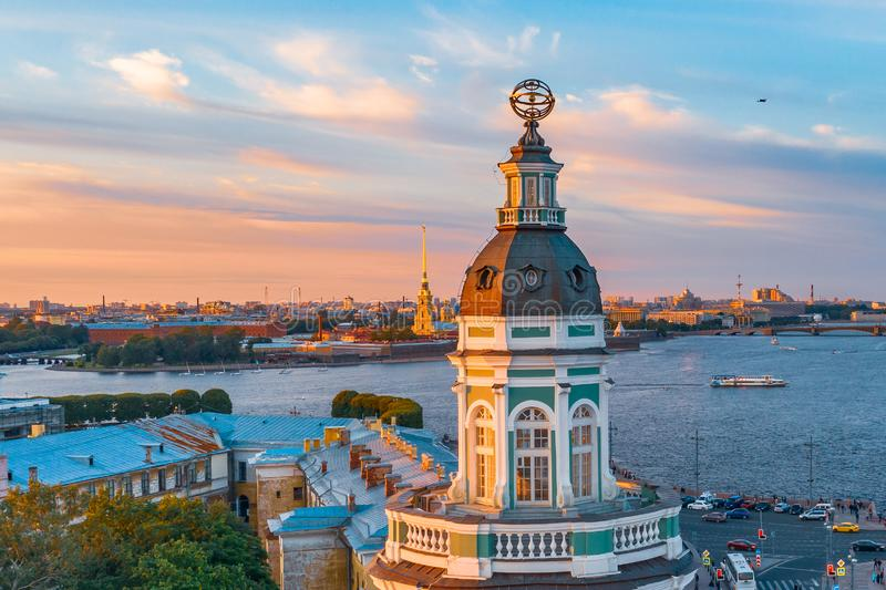 Kunstkamera at sunset on a summer evening and in the background Rostral columns on the Spit of Vasilyevsky Island and the Peter royalty free stock photography