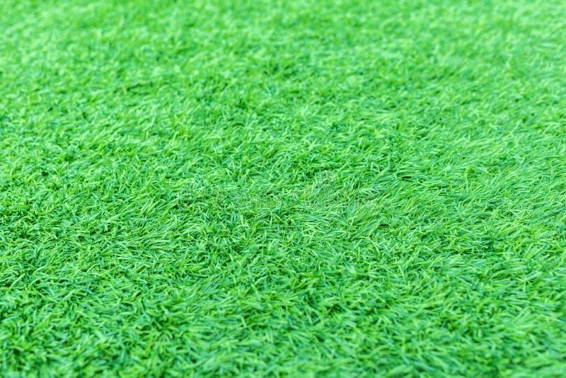 Kunstmatig groen gras of astroturf voor achtergrond stock afbeelding