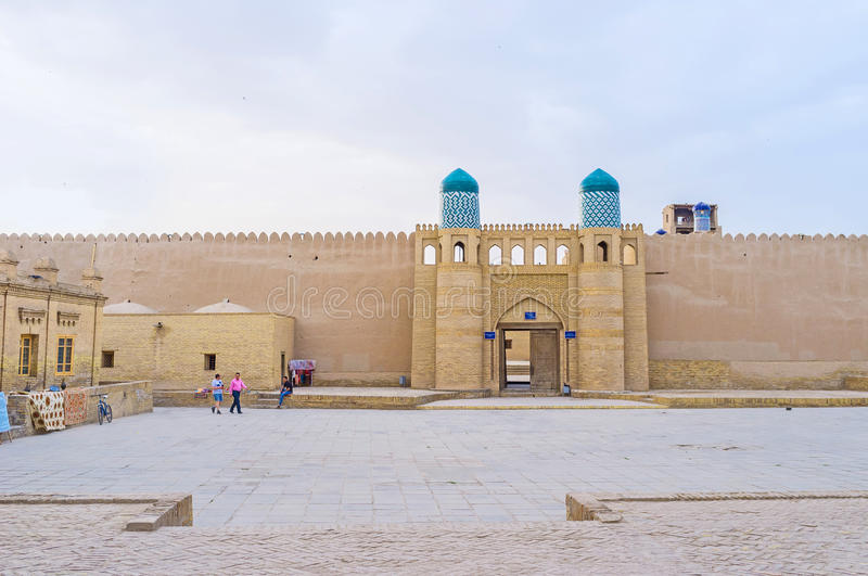 The Kunya-Ark Gates. KHIVA, UZBEKISTAN - MAY 3, 2015: The massive Gates to the Kunya-Ark inner fortress, that serves as historic museum, on May 3 in Khiva royalty free stock image
