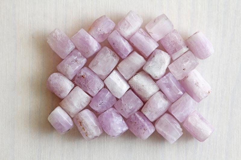 Kunzite is a natural pink stone for creating Jewelry. Natural crystals of pink and lilac stones royalty free stock photos