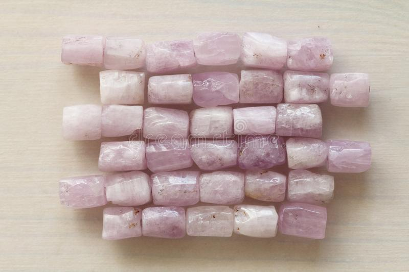 Kunzite is a natural pink stone for creating Jewelry. Natural crystals of pink and lilac stones stock photography