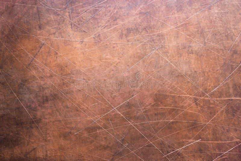 Kupferne Beschaffenheit oder Bronze, rustikale Metalloberfläche stockfotografie