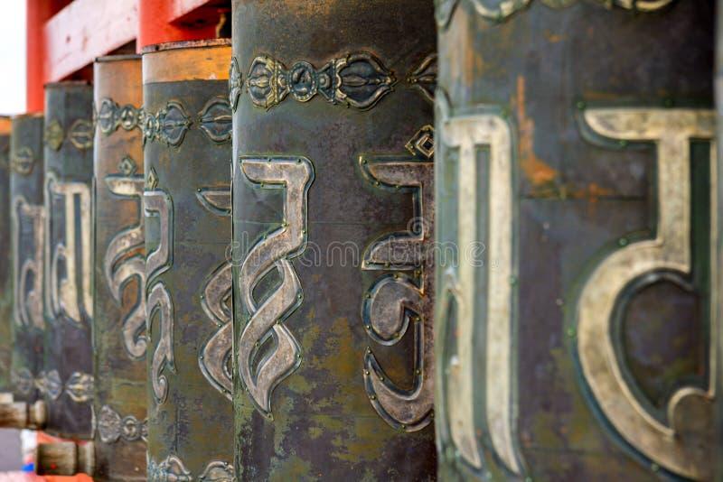 Kupferne buddhistische Gebetstrommeln Hurde stockfotos
