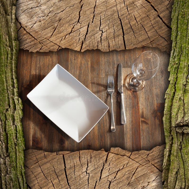 Kupongbakgrund för en lantlig matställe arkivfoton