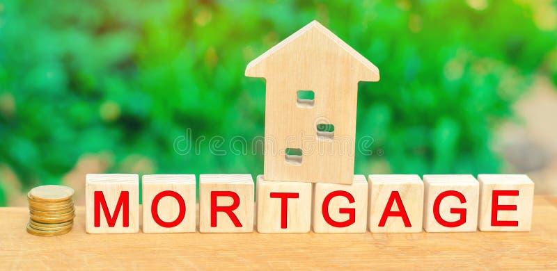 kupowała domu miniatury pojęcia pieniędzy Drewniani bloki i wpisowy ` hipoteki ` kredyt dla własności, mieszkania/ Biznesowe poży zdjęcia stock