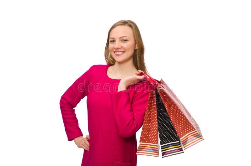 Kupujący dziewczyna w menchiach ubiera mienie plastikowych worki zdjęcia royalty free