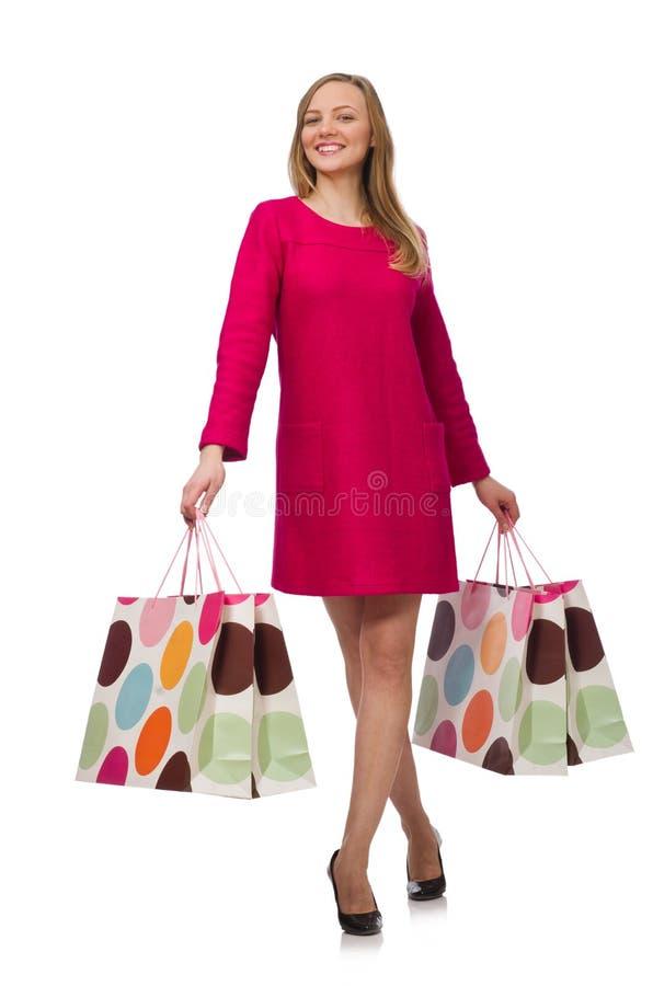 Kupujący dziewczyna w menchiach ubiera mienie plastikowych worki na whit fotografia royalty free