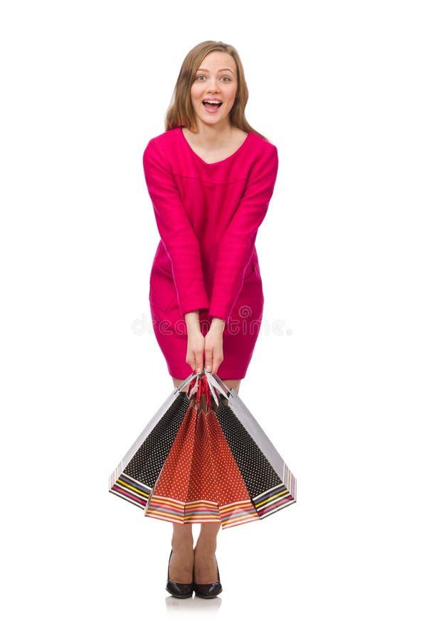 Kupujący dziewczyna w menchiach ubiera mienie plastikowych worki odizolowywających na whit zdjęcie royalty free