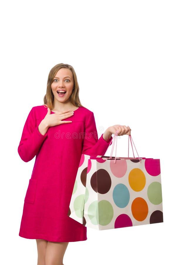 Kupujący dziewczyna w menchiach ubiera mienie plastikowych worki odizolowywających na whit zdjęcia royalty free