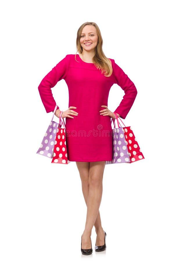 Kupujący dziewczyna w menchiach ubiera mienie plastikowych worki odizolowywających na whit zdjęcia stock