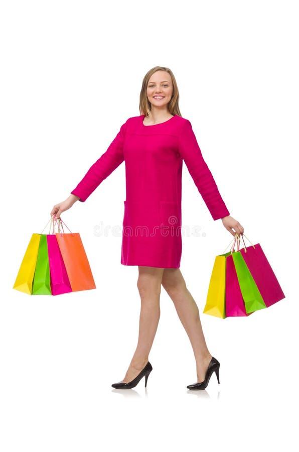 Kupujący dziewczyna w menchiach ubiera mienie plastikowych worki odizolowywających na whit obraz royalty free