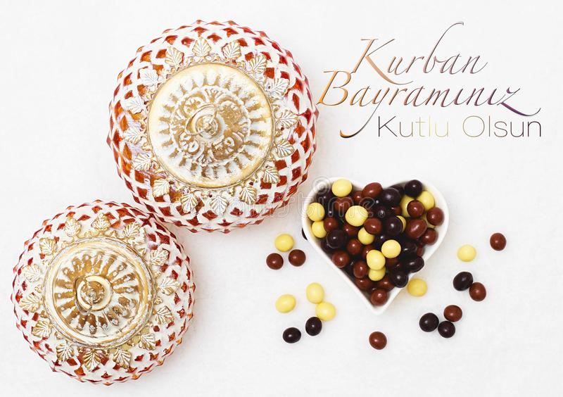Kurban Bayramı sacrifice festival, Islamic Arabic candle and ch. Ocolate sugar. Kurban bayraminiz kutlu olsun means happy festival of sacrifices royalty free stock photo