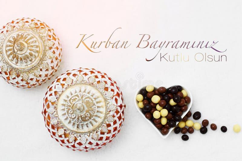 Kurban Bayramı sacrifice festival, Islamic Arabic candle and ch. Ocolate sugar. Kurban bayraminiz kutlu olsun means happy festival of sacrifices royalty free stock images