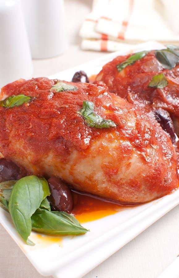 Kurczaków uda z pomidorowym kumberlandem obraz stock