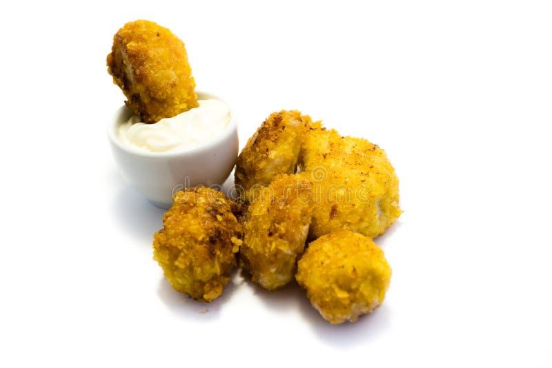Kurczak bryłki odizolowywać na białym tle zdjęcia stock