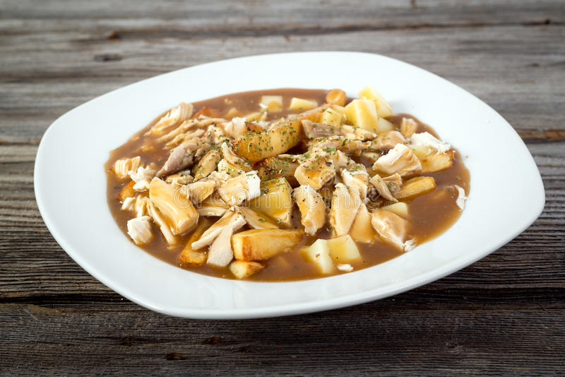 Kurczaka poutine Quebec kuchnia fotografia stock