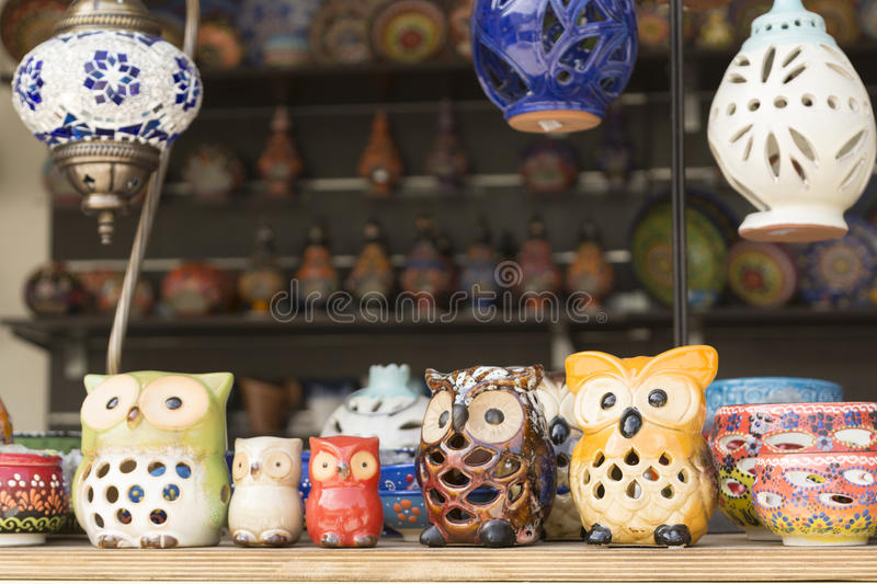 Kurnas lake, Island Crete, Greece, - June 8, 2017: The shelf with Greek hand-made souvenirs - colorful ceramic cups and plates wit royalty free stock photo