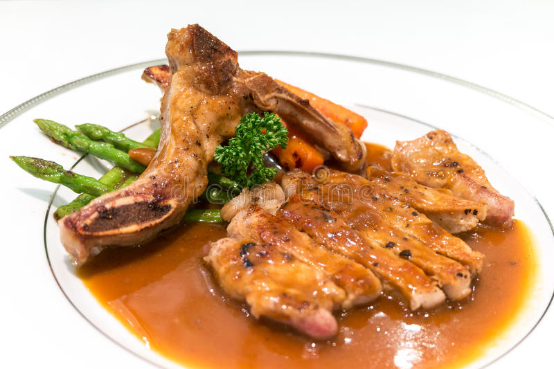 Kuro Buta. (Black pork) pork chop steak on dish. It is a Japanese cuisine royalty free stock image
