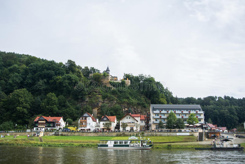 KURORT RATHEN, GERMANY - AUGUST 4, 2016: A view to Kurort Rathen ferry, Elbe river and Bastei mountains royalty free stock photography