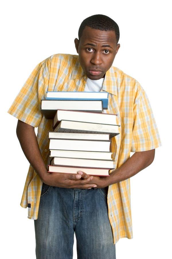 Kursteilnehmer-tragende Bücher lizenzfreie stockfotos