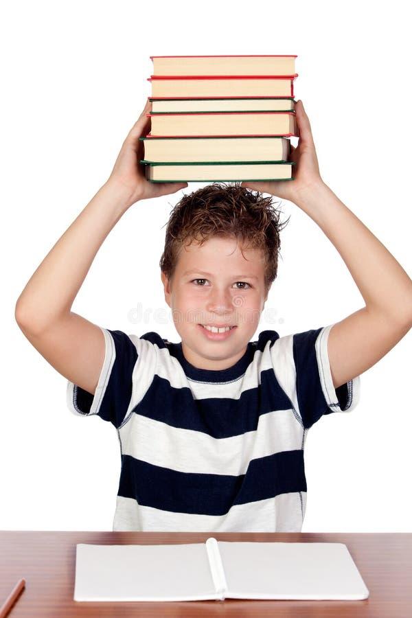 Kursteilnehmerkind mit vielen Büchern stockbilder