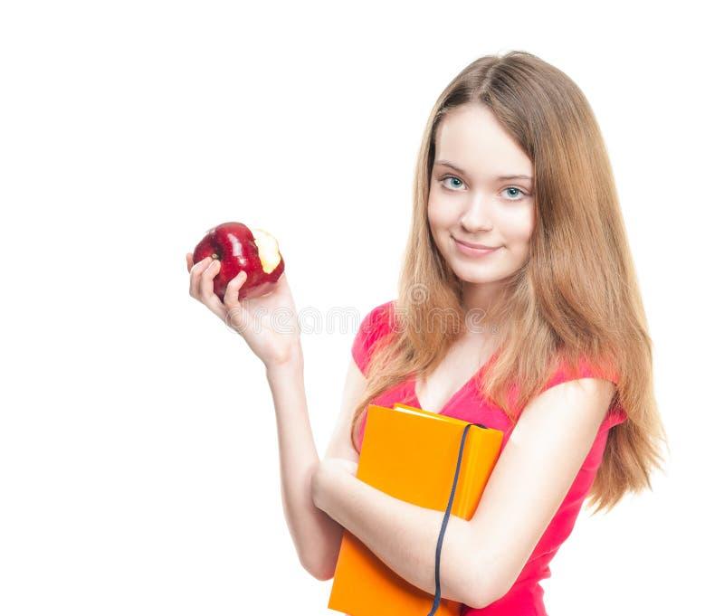 Kursteilnehmermädchen, das Apfel isst. stockfotos