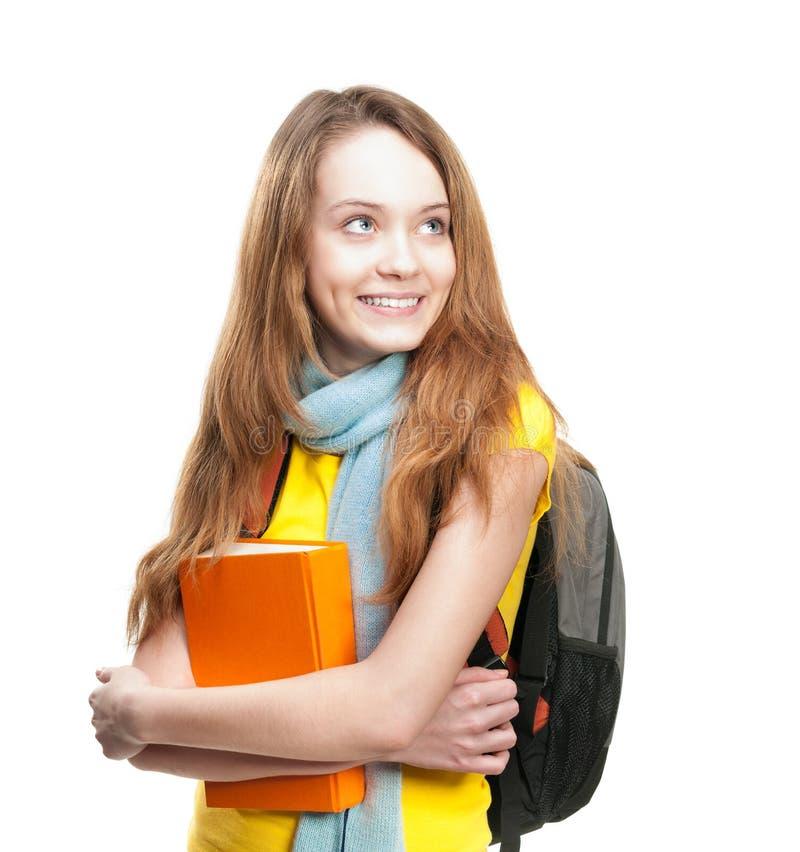 Kursteilnehmermädchen mit Buch und Rucksack. stockfoto