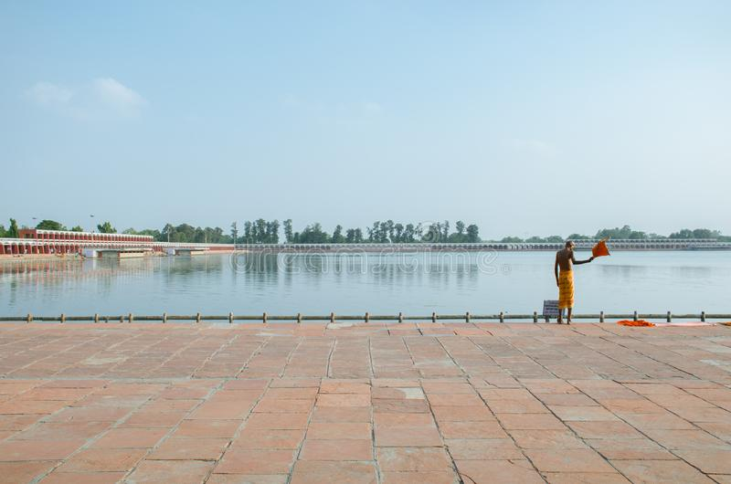 KURUKSHETRA, HARYANA, INDIA. 19 JUNE 2016 - portrait of an Indian sadhu holy man preparing to take a bath in holy tank stock photo