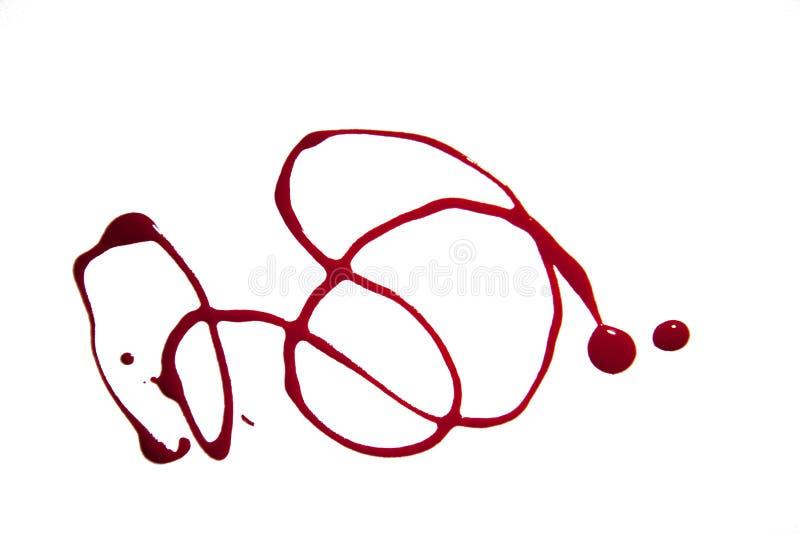 Kurven gemacht vom Nagellack im Rot lizenzfreies stockfoto