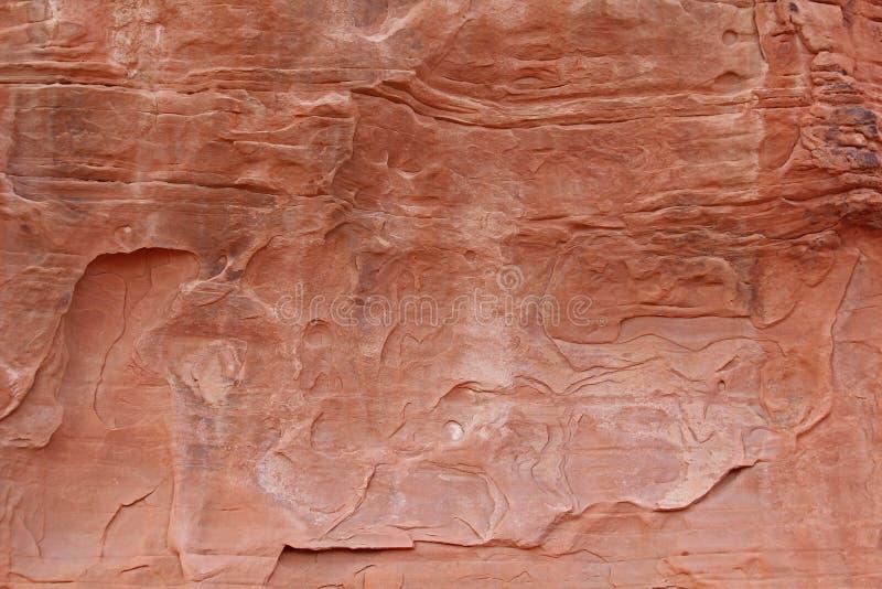 Kurvor för bakgrund för röd sandsten slitna fotografering för bildbyråer