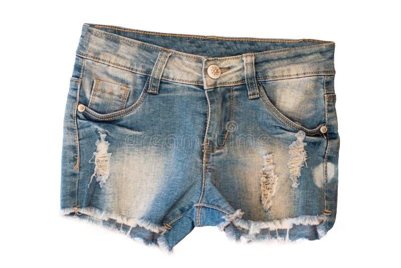 Kurze Jeanshose lokalisiert Modische stilvolle kurze Jeanshosen für das Kindermädchen lokalisiert auf einem weißen Hintergrund Mo stockfotos